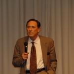 John Mack presenting at conference